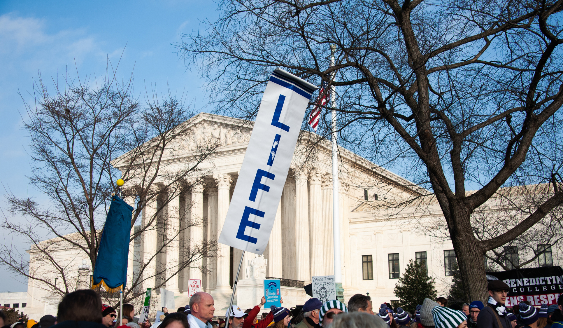 Marchers carry signs at U.S. Supreme Court