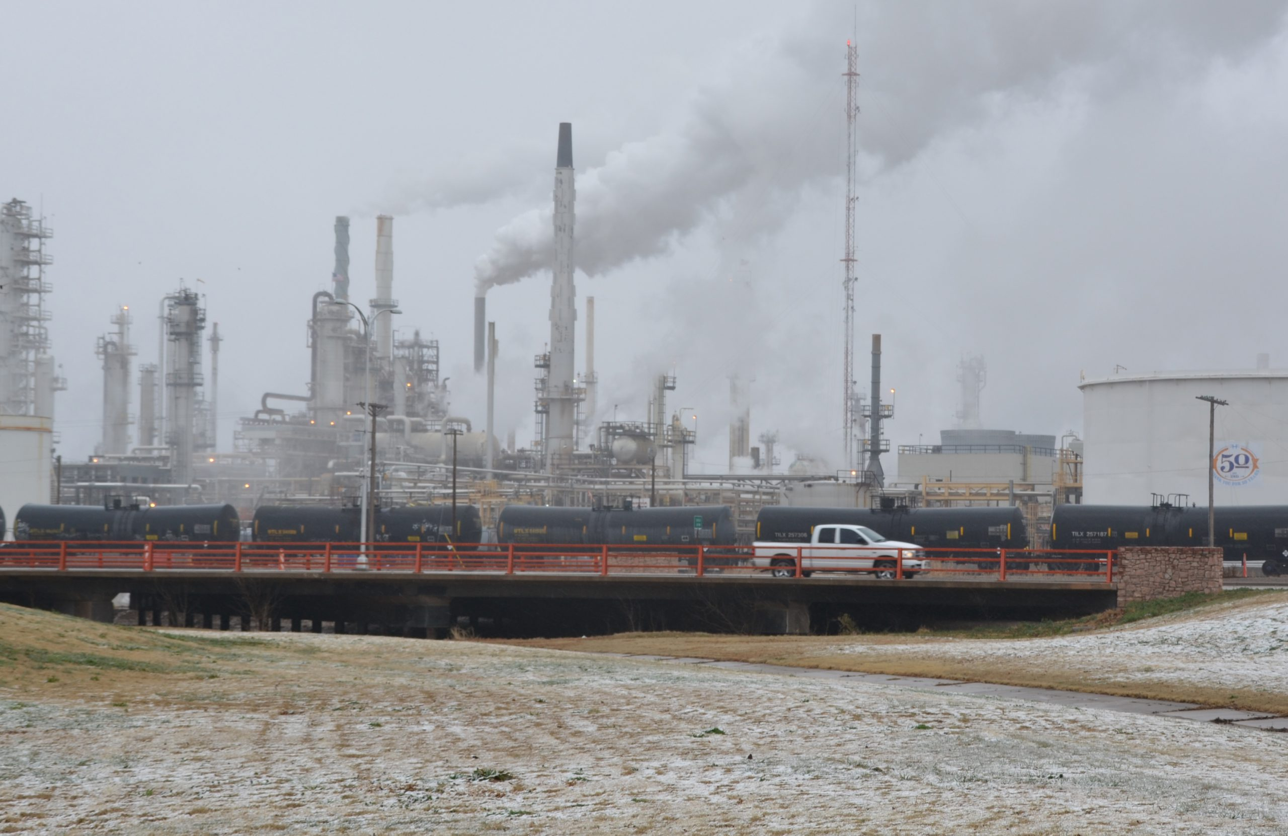 refinery with smokestacks