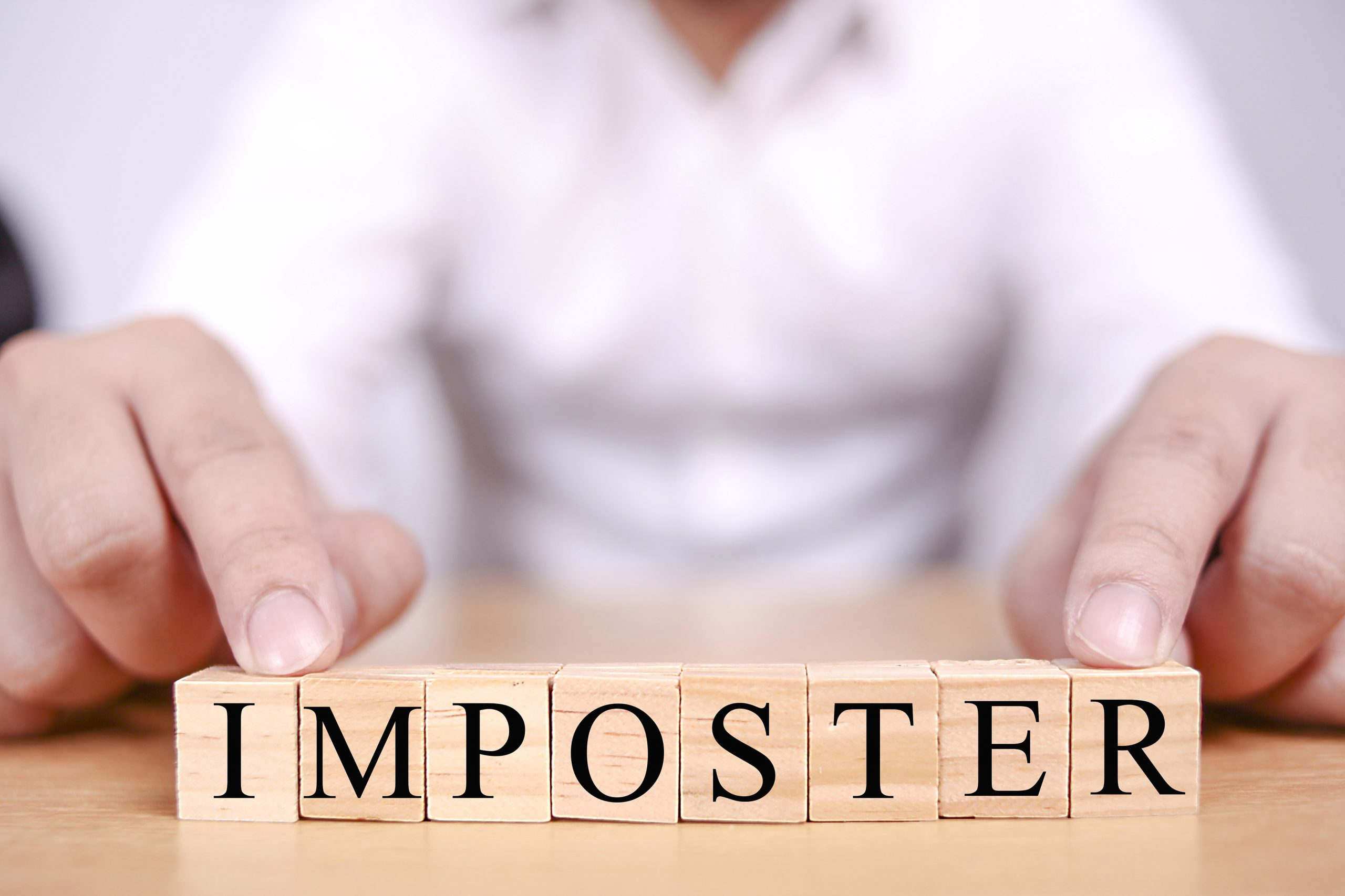 IMPOSTER spelled out in blocks