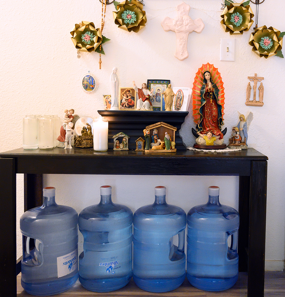 Water bottles under a home shrine