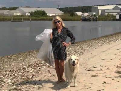 Kathy O'Hara and a friend, collecting trash on a beach in Virginia. In the mid-1980s, she helped to launch the International Coastal Cleanup, an annual event that mobilizes communities to collect and document beach litter. (Kathryn O'Hara)