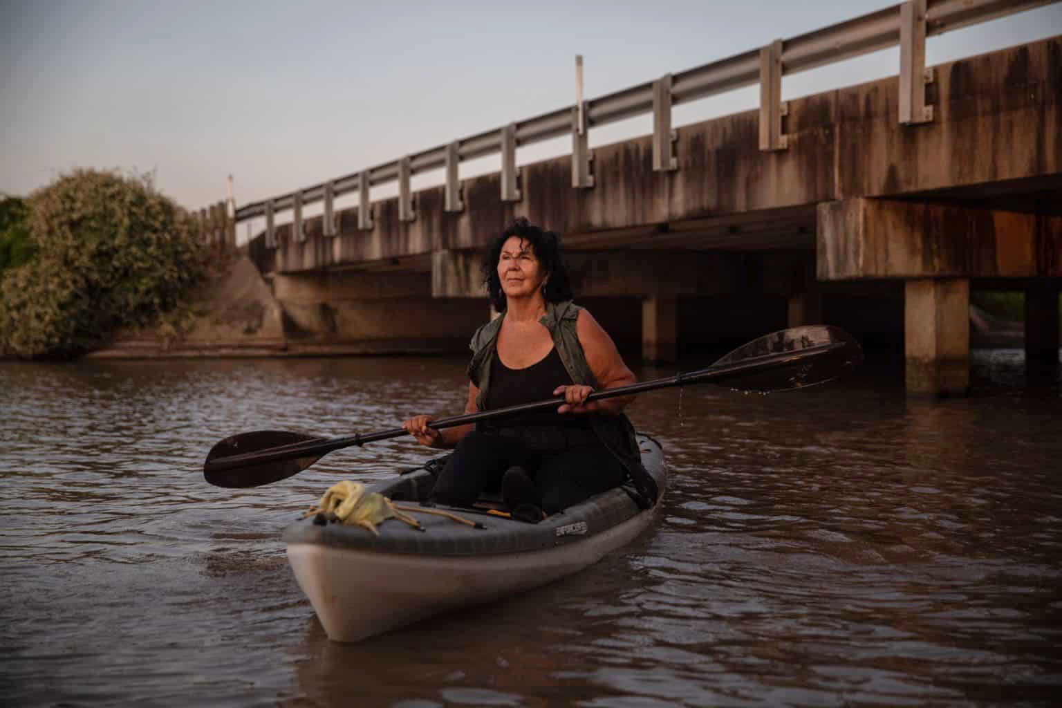 Diane Wilson investigating microplastic pollution on Cox's Creek in the Texas Gulf Coast town of Point Comfort. She led a group of local residents in a successful courtroom assault on giant Formosa Plastics. (Tamir Kalifa)