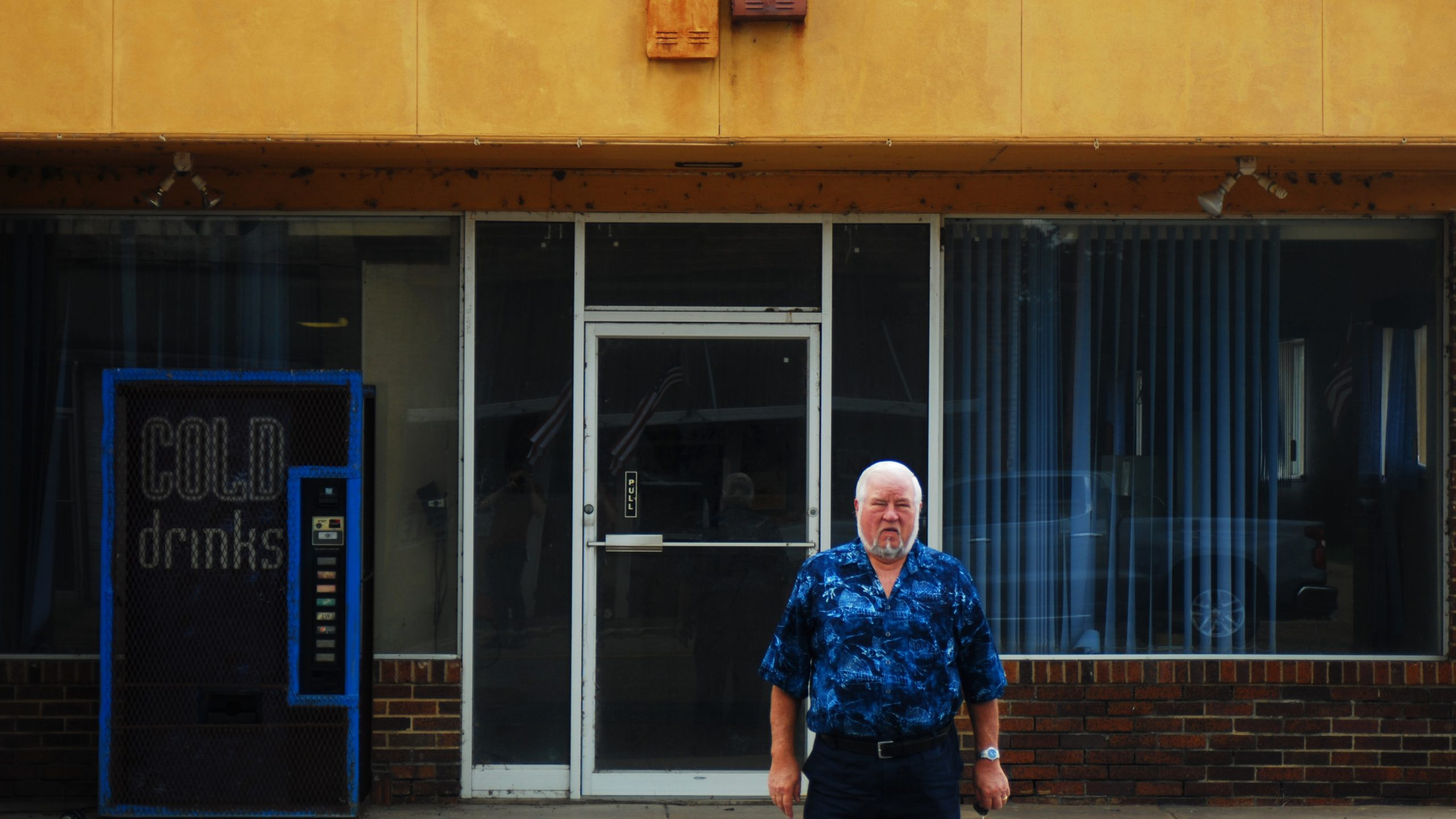 Noel Bailey in front of vacant storefront