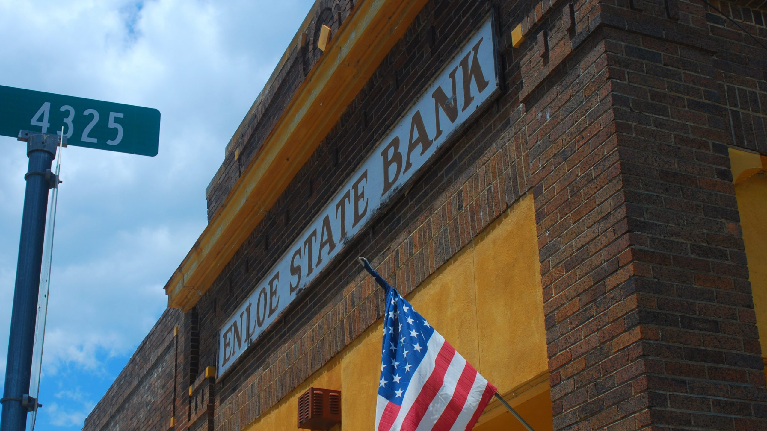 bank building with old sign