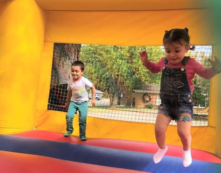 Children jumping in a bounce house