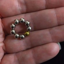 ring of ball magnets in the palm of a hand