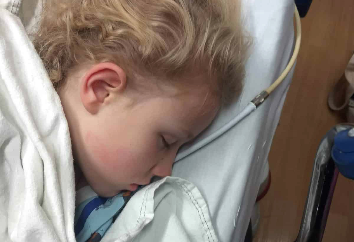 Child sleeping on hospital bed