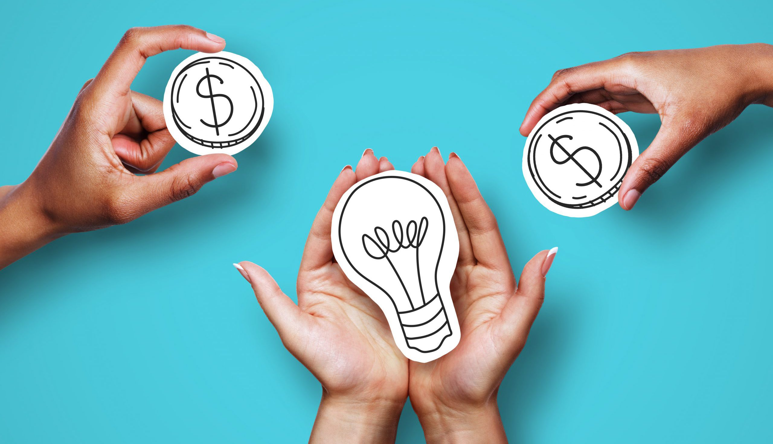hands holding cutouts of dollar signs and a lightbulb