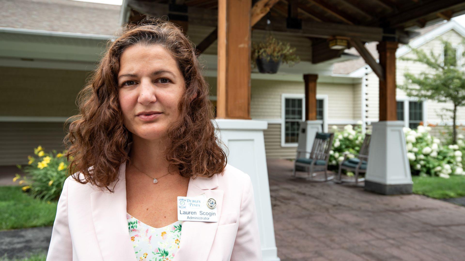 Lauren Scogin in front of Durgin Pines facility