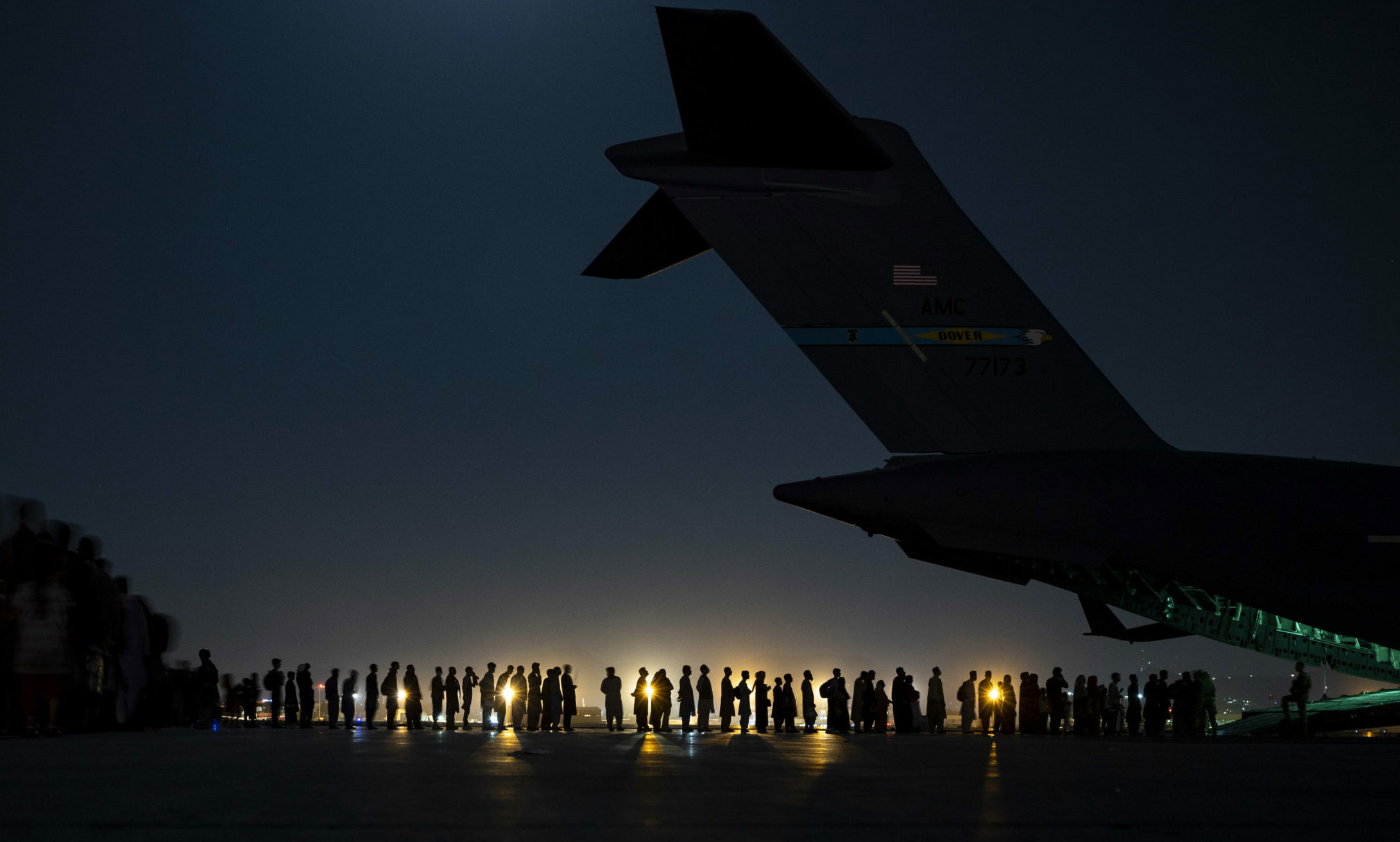 Evacuees from Afganistan boarding military plane at night