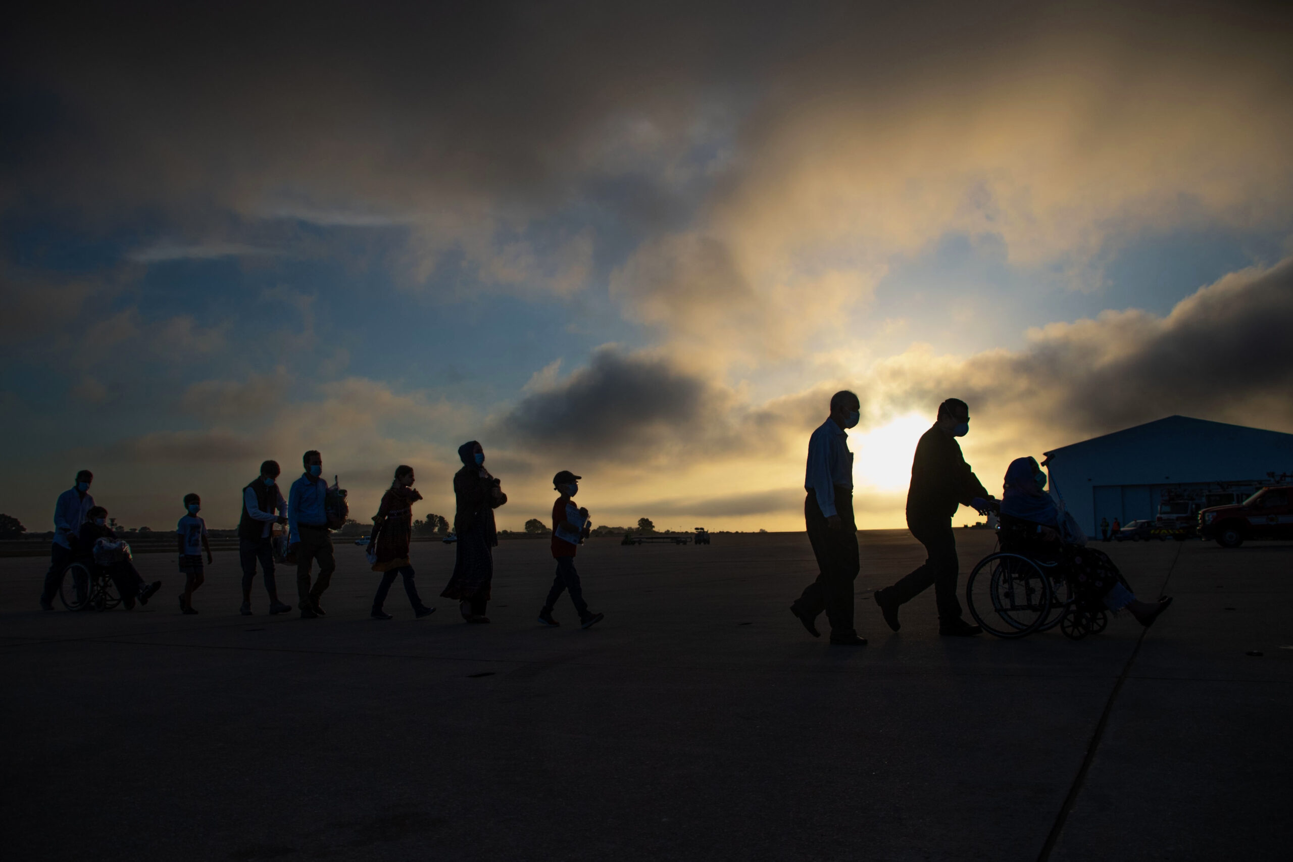Evacuees boarding military plane at night