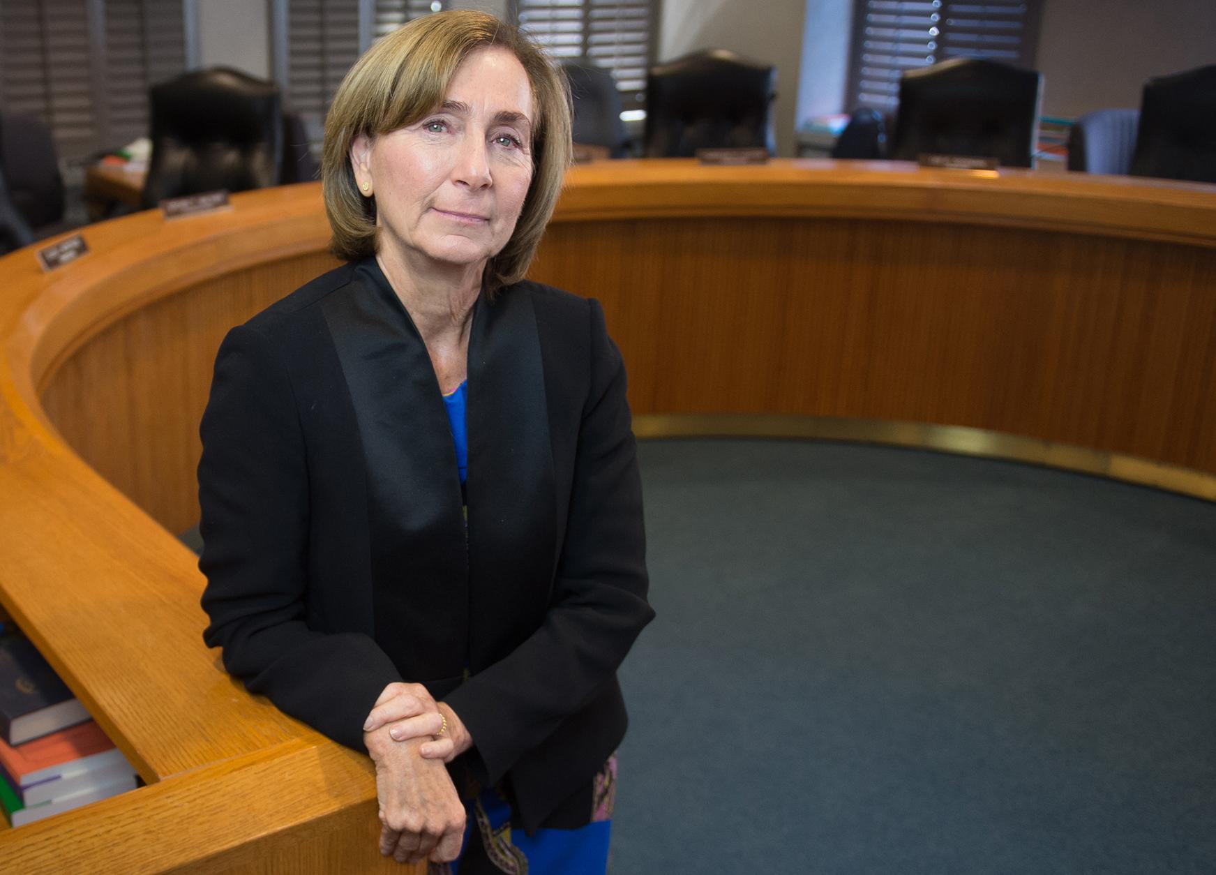 Ann Ravel standing in front of desk