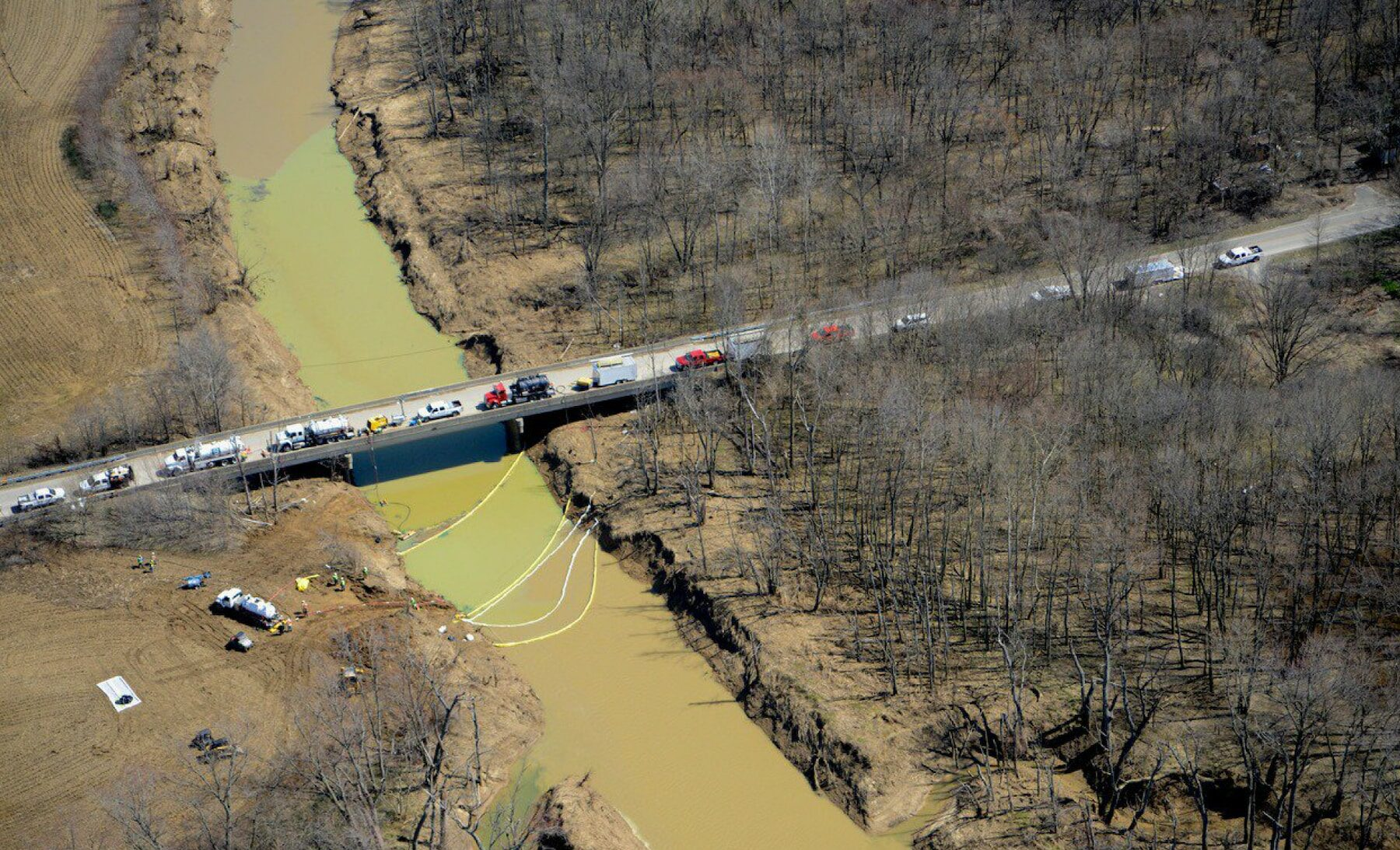 Overhead view of oil spill in waterway